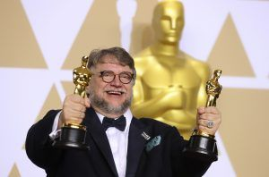 """Guillermo del Toro with the Best Director Award and the Best Picture Award for """"The Shape of Water"""" REUTERS/Mike Blake"""